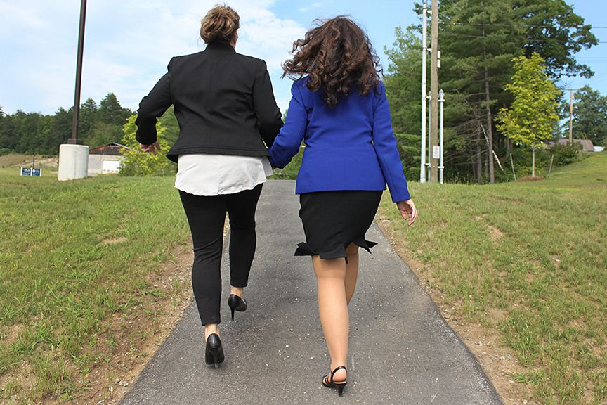 Maryanne Aldrich (left), Community Relations and Fund Development Director at Cottage Hospital, holds hands and skips with Maria Ryan, Cottage Hospital CEO, on their way to Rowe Health Center on July 19, 2017, in Haverhill, N.H. (Valley News - Charles Hatcher) Copyright Valley News. May not be reprinted or used online without permission. Send requests to permission@vnews.com.