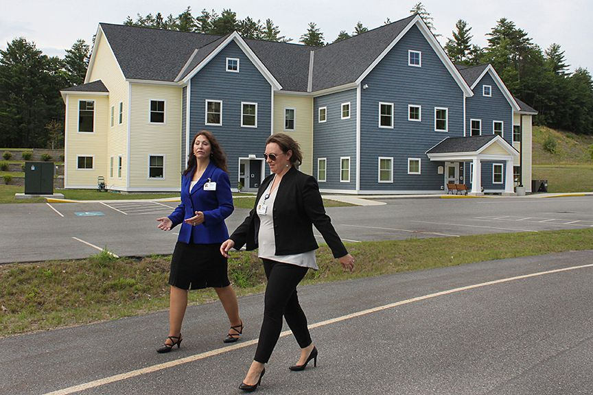 Maria Ryan (left), CEO of Cottage Hospital, walks with Maryanne Aldrich, Community Relations and Fund Development Director with Cottage Hospital, from the Rowe Health Center to Cottage Hospital on July 19, 2017, in Haverhill, N.H. Outside of work, Ryan and Aldrich will spend time together, often going to the gym.  (Valley News - Charles Hatcher) Copyright Valley News. May not be reprinted or used online without permission. Send requests to permission@vnews.com.