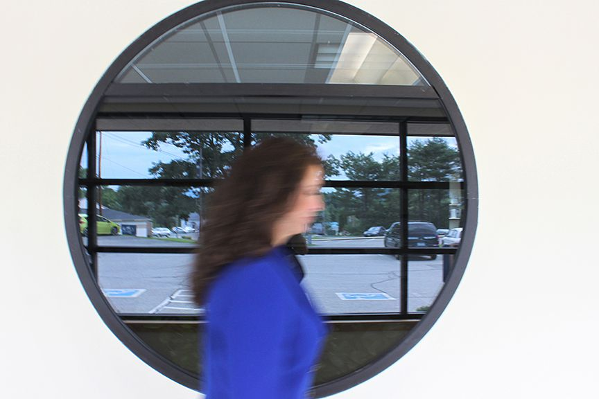 """Maria Ryan, CEO of Cottage Hospital, walks through a corridor on Wednesday, July 19, 2017, at Cottage Hospital in Haverhill, N.H. """"My meeting schedule is like a hamster wheel, but if I have five minutes sometimes I'll just go and ask permission to go in and meet patients,"""" she says. """"And it just fills my heart."""" (Valley News - Charles Hatcher) Copyright Valley News. May not be reprinted or used online without permission. Send requests to permission@vnews.com."""