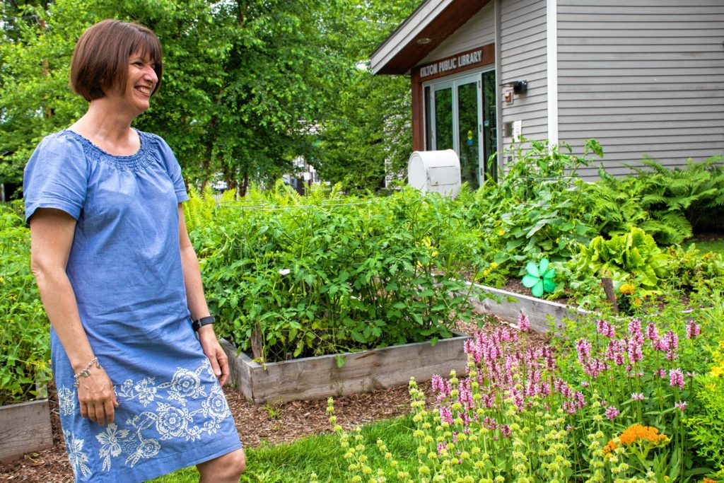The library boasts a community garden on the site of the former wood pellet silo. On a quick break, Amy Lappin Deputy Director of the Lebanon Public Libraries takes a little time to enjoy some of the wildflowers. Nancy Nutile-McMenemy photograph.