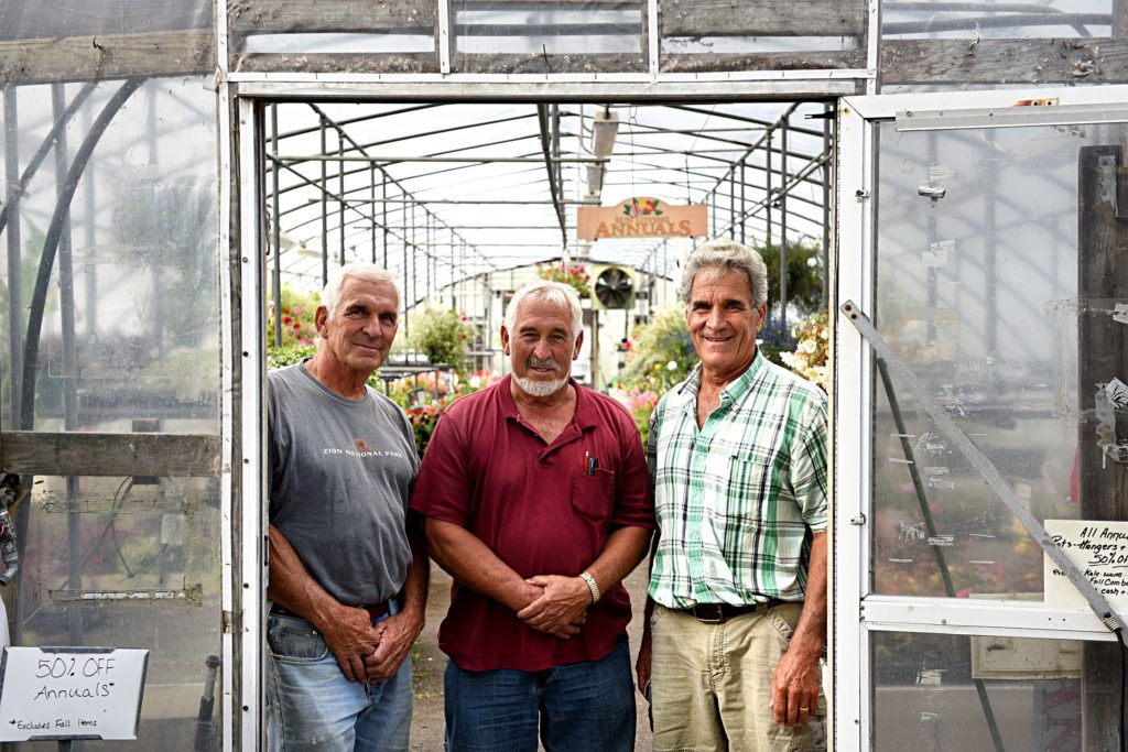 Jim, left, Norm, and Joe Longacre at Longacres' Nursery Center in Lebanon, N.H., on Sept. 7, 2017.(Valley News - Jennifer Hauck) Copyright Valley News. May not be reprinted or used online without permission. Send requests to permission@vnews.com.