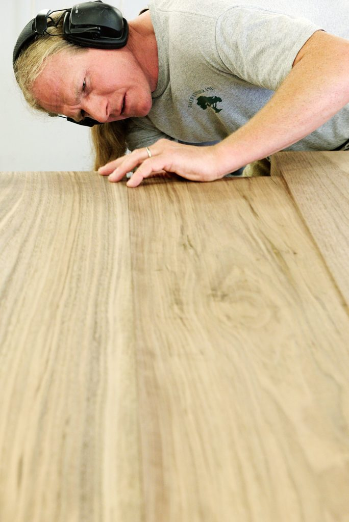 Cabinet maker Andy Mulligan measures the thickness of walnut boards that will be joined to make a countertop for a residential customer in the Trumbull-Nelson Construction Company's carpentry shop in Hanover, N.H., Thursday, September 15, 2017. Trumbull-Nelson is celebrating 100 years since its founding in 1917. (Valley News - James M. Patterson) Copyright Valley News. May not be reprinted or used online without permission. Send requests to permission@vnews.com.