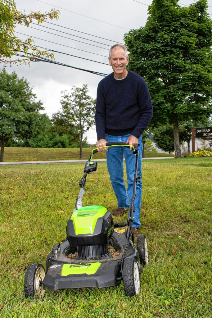 Jamie Hess, a member of the New London (N.H.) Energy Committee, shows off his electric lawnmower on display at the second annual Upper Valley Electric Vehicle Expo on Sept. 9 at Dothan Brook School in Hartford, Vt. (Nancy Nutile-McMenemy photograph)