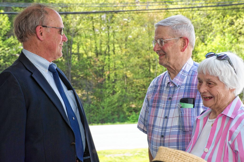 Trumbull-Nelson Construction Co. Executive Vice President Ron Bauer, left, speaks with Jack and Jane DeGange at the company's 100th anniversary celebration in Hanover, N.H., on May 18, 2017. Bauer has been with the company since 1981. Jane DeGange is the former director of David's House, built by Trumbull-Nelson. (Nancy Nutile-McMenemy photograph)