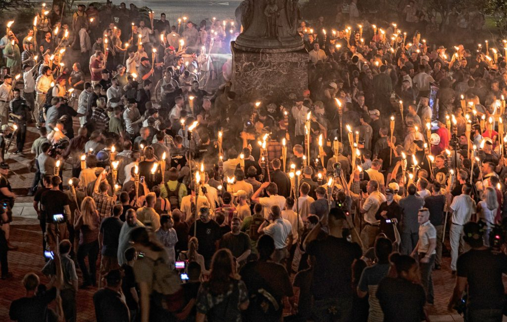 """Chanting """"white lives matter!"""" and """"Jews will not replace us!"""" hundreds of neo-Nazis and white supremacists carried torches across the University of Virginia campus Aug. 11. MUST CREDIT: Evelyn Hockstein, The Washington Post."""
