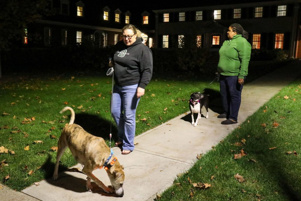 Jen Jones, left, of Hanover, N.H., walks with her wife, Dia Draper, also of Hanover, and their two dogs, Clay, left, and Sally on Monday, Oct. 23, 2017, outside of the Triangle House on the Dartmouth College campus in Hanover, N.H. The couple live at the Triangle House as live-in advisors for LGBTQIA+ students living on campus. (Valley News - Charles Hatcher) Copyright Valley News. May not be reprinted or used online without permission. Send requests to permission@vnews.com