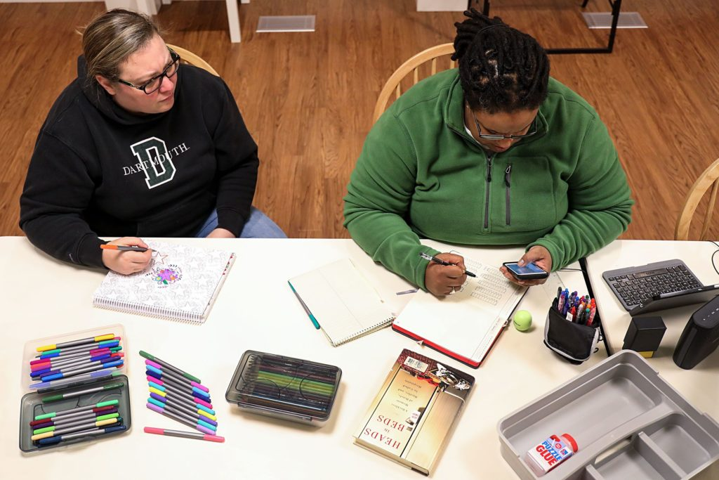 Jen Jones, left, of Hanover, N.H., draws in a coloring book as her wife, Dia Draper, also of Hanover, works on a bullet journal on Monday, Oct. 23, 2017, in the common area at the Triangle House on the Dartmouth College campus in Hanover, N.H. The couple live at the Triangle House as live-in advisors for LGBTQIA+ students living on campus. (Valley News - Charles Hatcher) Copyright Valley News. May not be reprinted or used online without permission. Send requests to permission@vnews.com