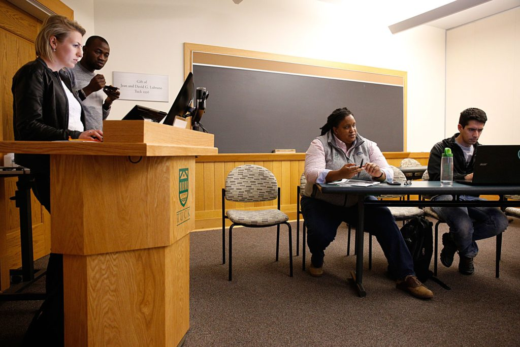 Dia Draper, director of strategic initiatives at the Tuck School of Business, answers questions from second-year students, including from left, Martina Ravelli, Martial Combari and Enrique Curiel, in Hanover, N.H., on Oct. 24, 2017, about their plans for the annual Tuck Diversity Conference held at the school in November. Seven students are co-chairs of the conference, held since 1994 for prospective students. (Valley News - Geoff Hansen) Copyright Valley News. May not be reprinted or used online without permission. Send requests to permission@vnews.com.
