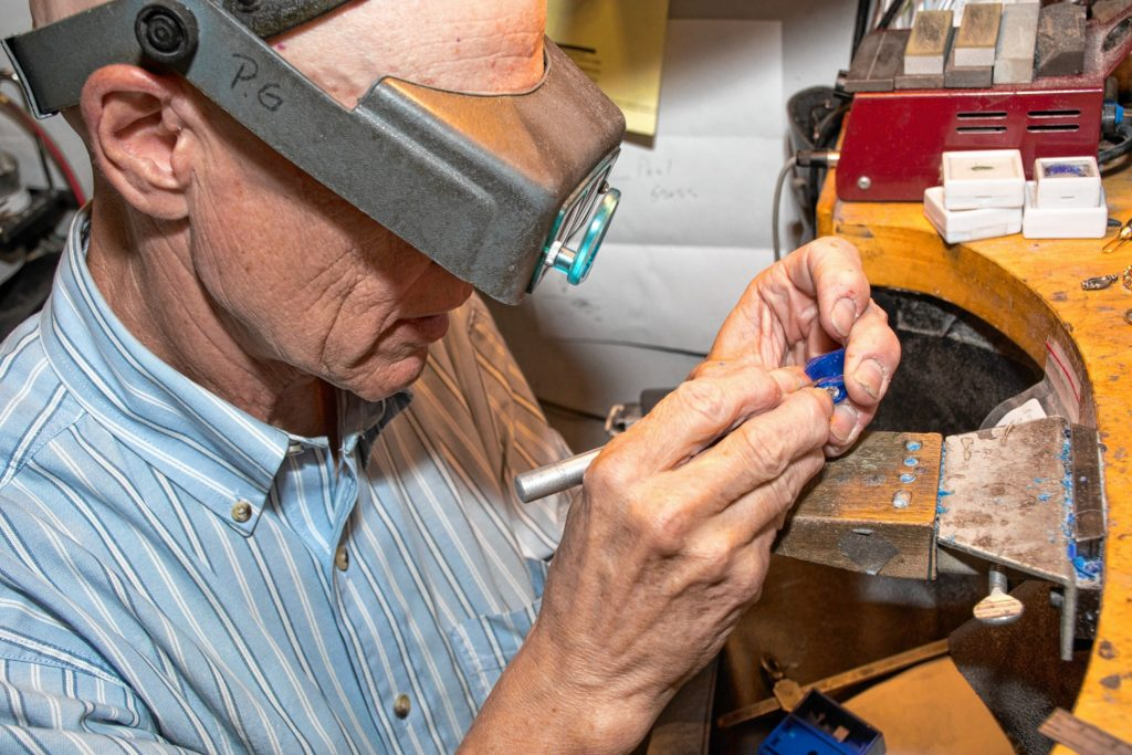 Paul Gross, of Designer Gold in Hanover, N.H., carves wax to create a custom band for a stone being reset for a customer. The wax will eventually be replaced with gold. (Nancy Nutile-McMenemy photograph)