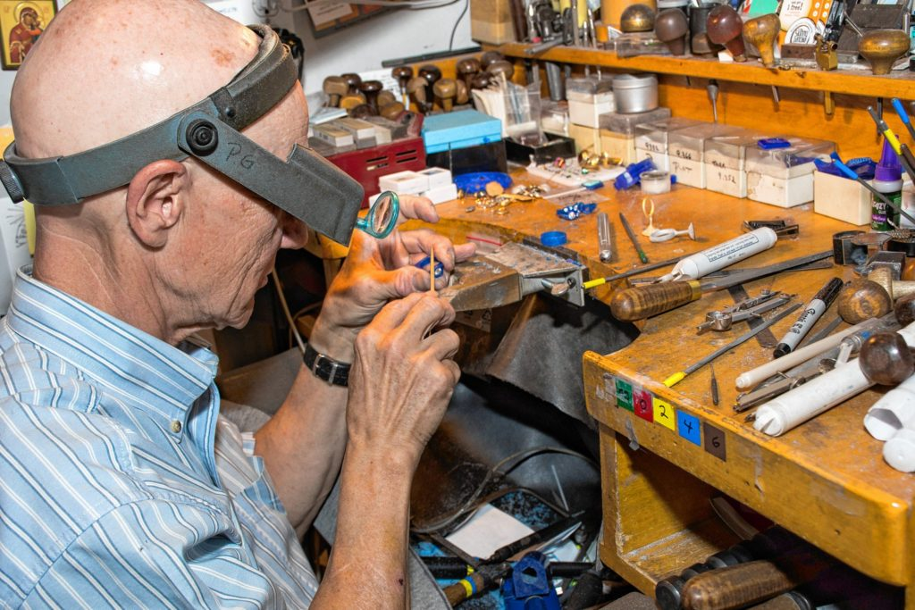 Paul Gross at his workbench at Designer Gold in Hanover, N.H. (Nancy Nutile-McMenemy photograph)