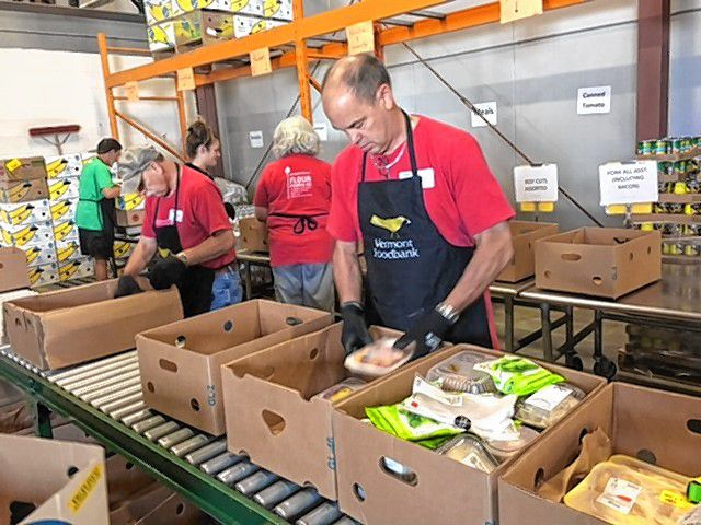 King Arthur Flour employees volunteer at the Vermont Foodbank in August. (Photograph courtesy of King Arthur Flour)