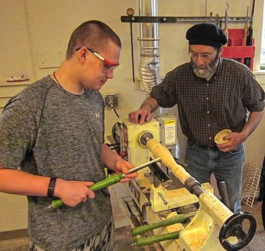 Mascoma High School student Alex Howe, left, works with Gary Wood of Gary R. Wood & Co. at the school's woodshop in 2017. (Photo by Dave Shinnlinger)