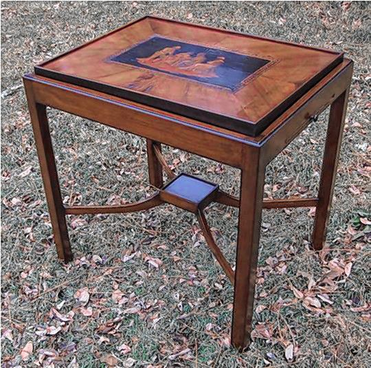 A custom table designed and finished by Gary R. Wood of Gary R. Wood & Co. The table complements an antique marquetry panel. (Photo courtesy of Gary R. Wood & Co.)