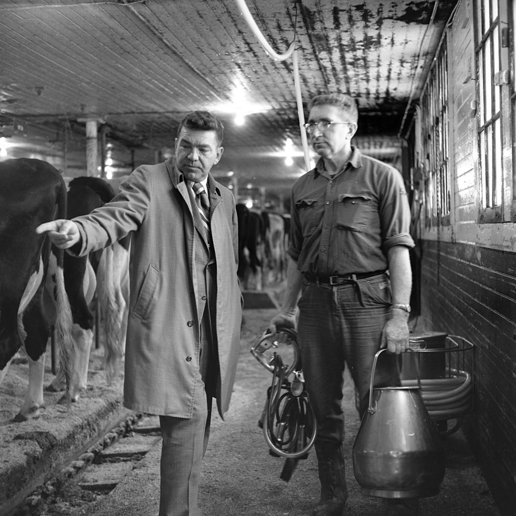 Supt. William Siegmund, left, discusses the herd at the Grafton County farm with herdsman Charles Page in North Haverhill, N.H., in Feb. 1973. The 90 county-owned cows produced more than one million pounds of milk in 1972, and income of $65,000. (Valley News - George Lambert) Copyright Valley News. May not be reprinted or used online without permission. Send requests to permission@vnews.com.