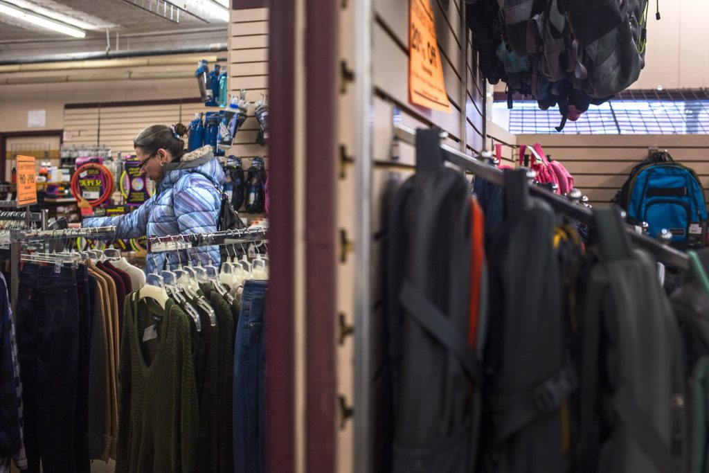 Cori Stackpole, of Newport, N.H., looks at a pair of pants during the closing sale at Hubert's Department Store in Newport on Feb. 1, 2018. Stackpole has been coming to the store since she was a teenager and said it will be sad to see the store go because there is not much in town. (Valley News - Carly Geraci) Copyright Valley News. May not be reprinted or used online without permission. Send requests to permission@vnews.com.