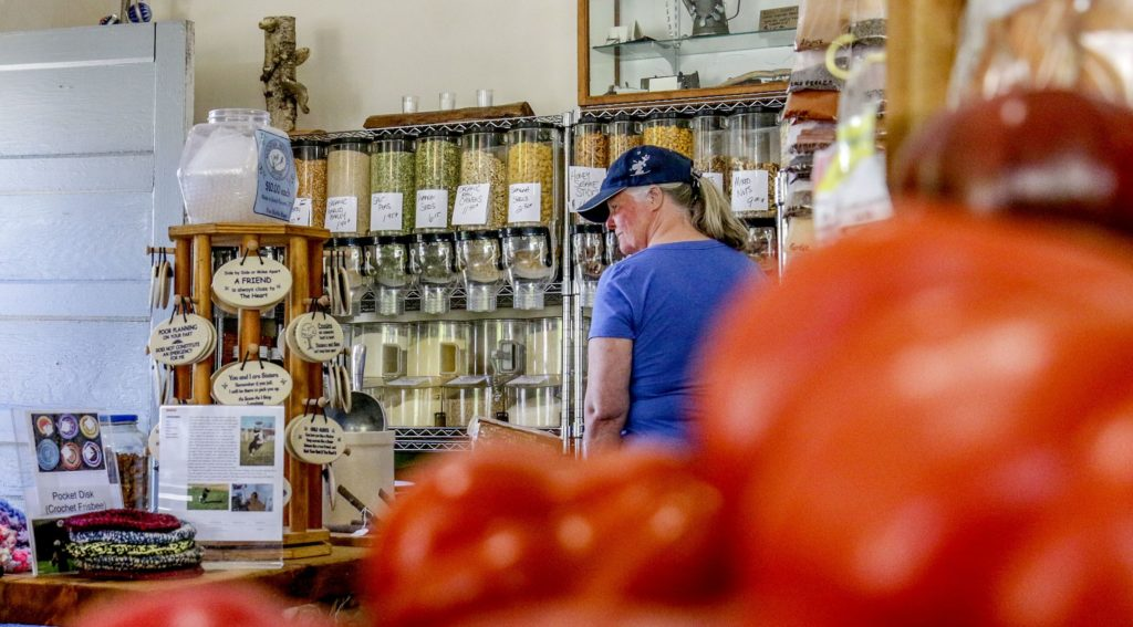 Owner of the My Farmers Market, Jennifer Bone makes adjustments to the selection of produce on Friday, June 22, 2018, in Groton, Vt. Bone started the market at its current location in October of 2017. (Valley News - August Frank) Copyright Valley News. May not be reprinted or used online without permission. Send requests to permission@vnews.com.