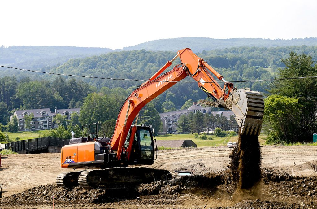 Glenn Seward operates an excavator as he builds new paths at the Ascutney mountain Base Lodge, in Brownsville, Vt., on Monday, July 2, 2018. (Valley News - August Frank) Copyright Valley News. May not be reprinted or used online without permission. Send requests to permission@vnews.com.