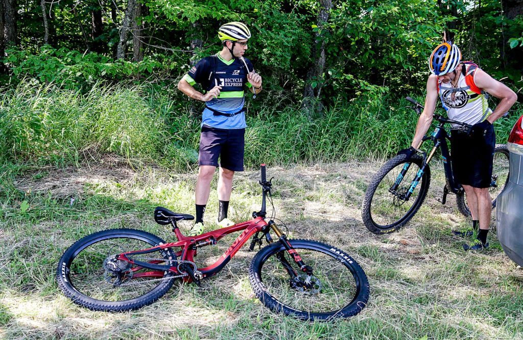David Crothers, of Waterbury, Vt., and Tyler Merritt, of Richmond, Vt., get ready for a mountain bike ride up Ascutney Mountain from the Base Lodge, in Brownsville, Vt., on Monday, July 2, 2018. (Valley News - August Frank) Copyright Valley News. May not be reprinted or used online without permission. Send requests to permission@vnews.com.