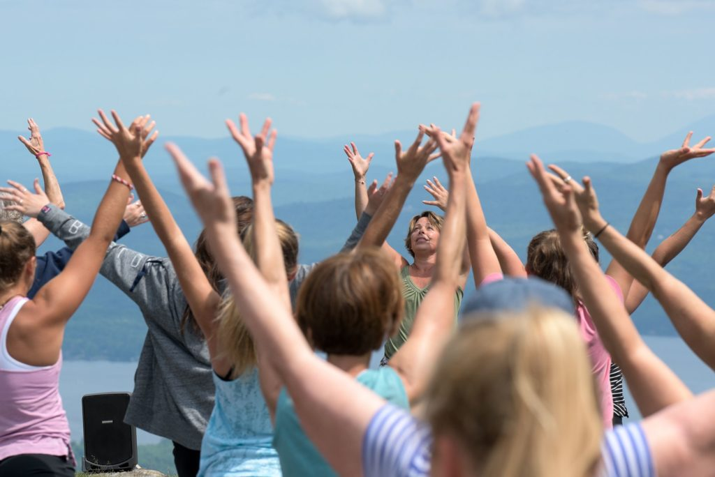 Yoga instructor Leigh Ann Root leads sun salutations durig her yoga class at the top of Mount Sunapee in Newbury, N.H., Wednesday, July 11, 2018. (Valley News - James M. Patterson) Copyright Valley News. May not be reprinted or used online without permission. Send requests to permission@vnews.com.