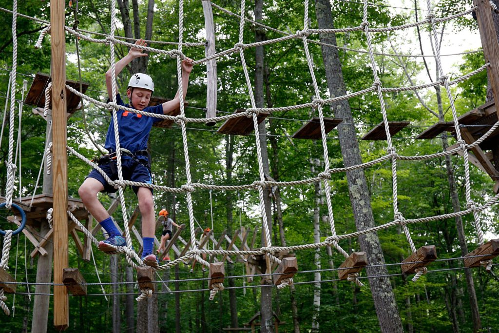 Ryan Flaherty, 12, of Foxborough, Mass., maneuvers through the Aerial Challenge Course at Mount Sunapee Resort's Adventure Park in Sunapee, N.H., on July 14, 2018. The resort has added several recreational activities for summertime enjoyment. (Valley News - Geoff Hansen) Copyright Valley News. May not be reprinted or used online without permission. Send requests to permission@vnews.com.