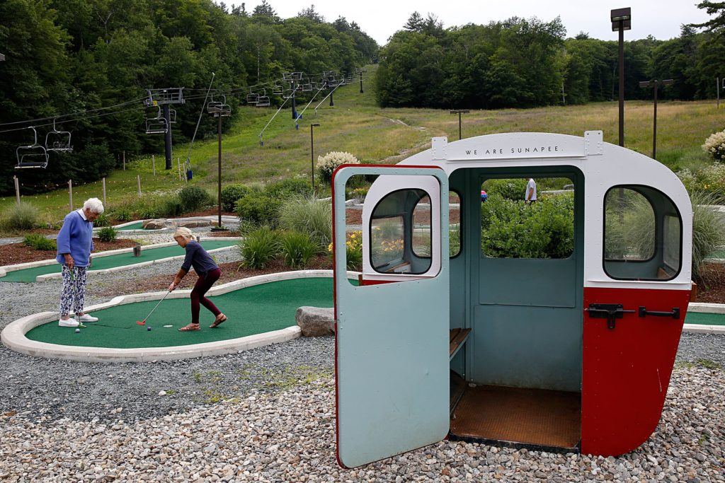 Betty Holcomb, of Newbury, N.H., watches her granddaughter Betty Holcomb, 10, of Durango, Colo., make a putt on the mini golf course at Mount Sunapee Resort's Adventure Park in Sunapee, N.H., on July 14, 2018. Betty Holcomb usually comes to visit her namesake once a year. (Valley News - Geoff Hansen) Copyright Valley News. May not be reprinted or used online without permission. Send requests to permission@vnews.com.