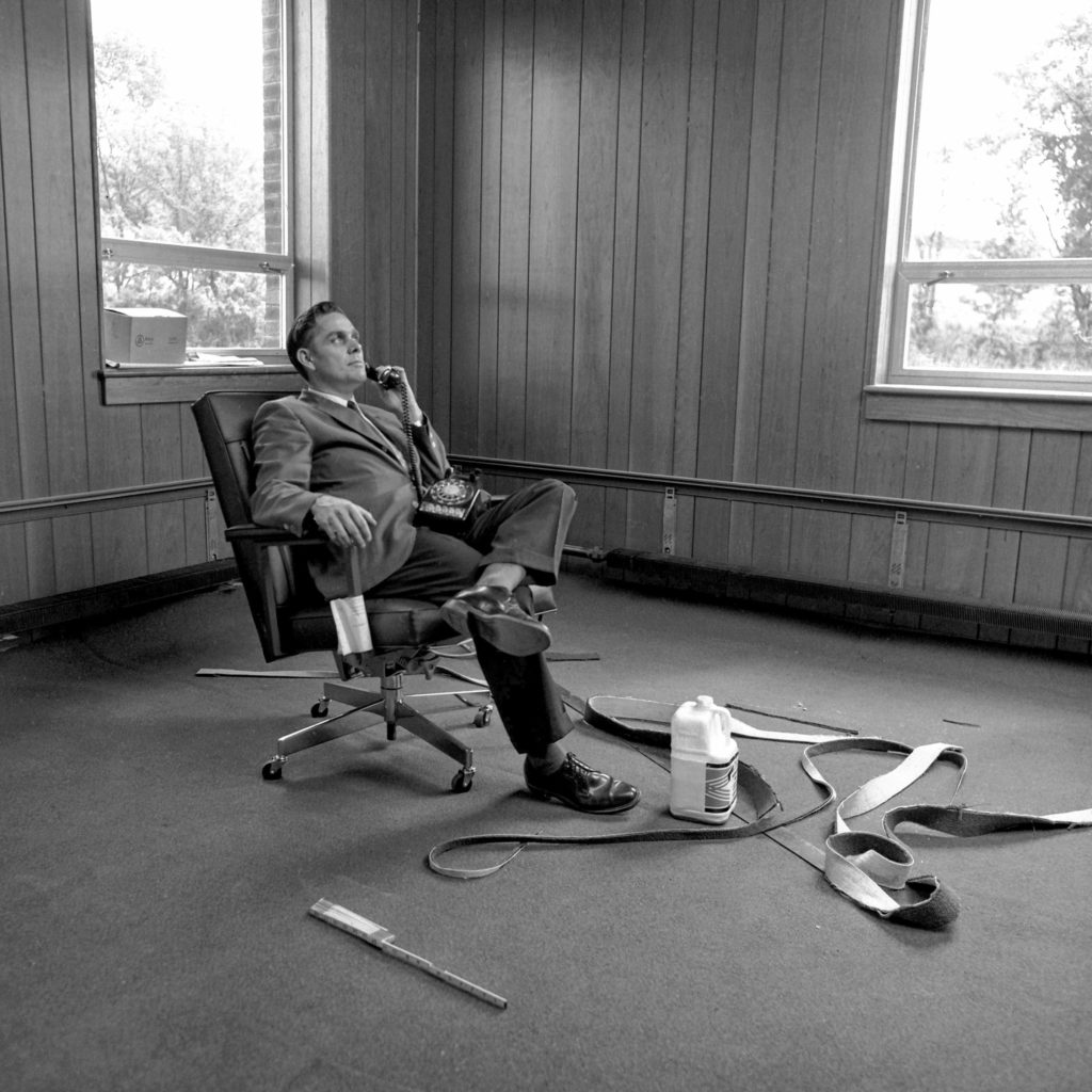 Roland Stoodley, director of New Hampshire Technical Institute in Claremont, N.H., has not fully moved into his office yet but he still takes time to answer a telephone inquiry about the school on Aug. 28, 1968. Classes at the new facility started a few days later on Sept. 3. (Valley News - Larry McDonald) Copyright Valley News. May not be reprinted or used online without permission. Send requests to permission@vnews.com.