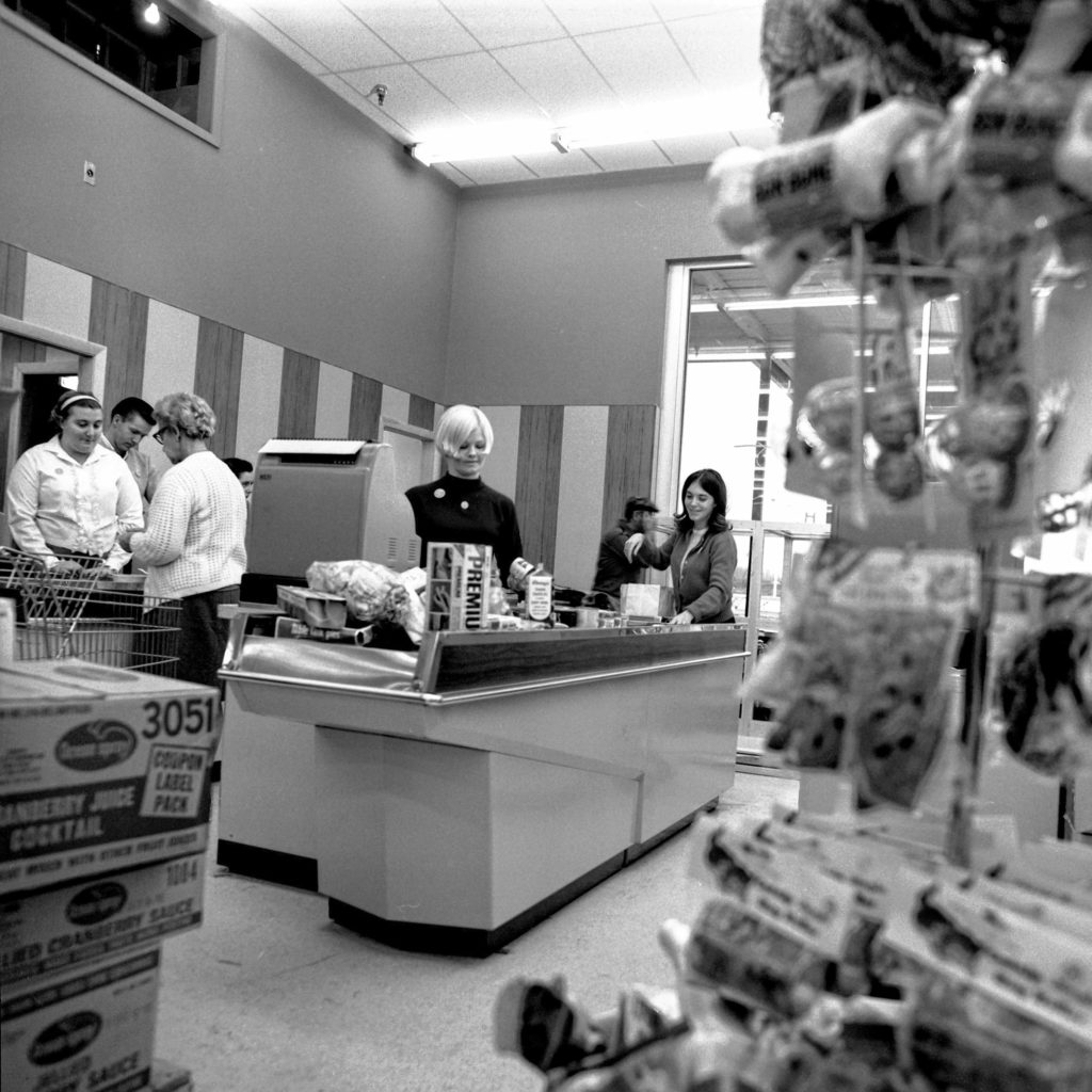 Cashiers at the Purity Supreme Supermarket, scheduled to open on Dec. 11, 1968, at the West Lebanon Shopping Center, practice up for the large customer turnout expected at the grand opening. Contractors were hard at work wrapping up the finishing touches while clerks stocked the shelves in West Lebanon, N.H. (Valley News - Larry McDonald) Copyright Valley News. May not be reprinted or used online without permission. Send requests to permission@vnews.com.