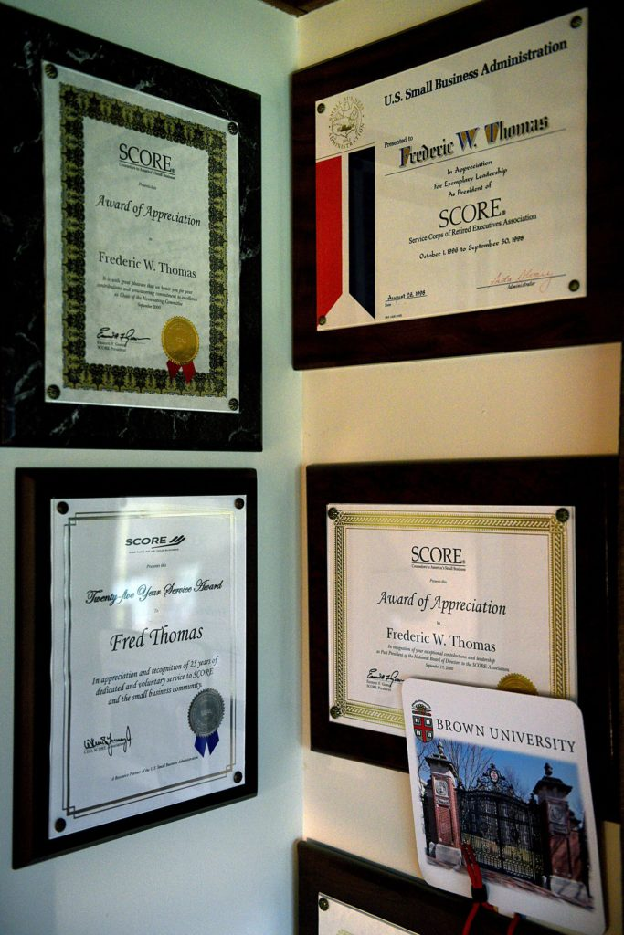 A collection of the honors and awards Fred Thomas has received for his work with SCORE is on display at his Thetford, Vt., home on Sept. 20, 2018. (Valley News - Jennifer Hauck) Copyright Valley News. May not be reprinted or used online without permission. Send requests to permission@vnews.com.