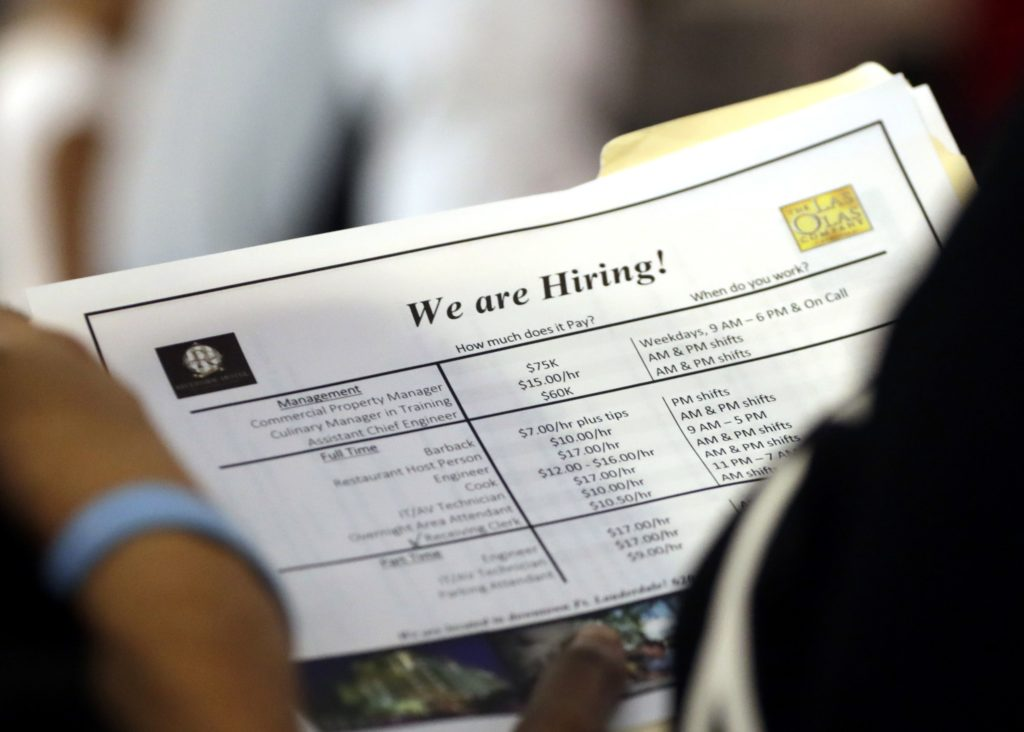 FILE In this June 21, 2018 file photo, a job applicant looks at job listings for the Riverside Hotel at a job fair hosted by Job News South Florida, in Sunrise, Fla. The U.S. unemployment rate fell to 3.7 percent in September 2018 the lowest level since December 1969 — signaling how the longest streak of hiring on record has put millions of Americans back to work. Employers added just 134,000 jobs last month, the fewest in a year, the Labor Department said Friday, Oct. 5. But that figure was likely depressed by the impact of Hurricane Florence. (AP Photo/Lynne Sladky)