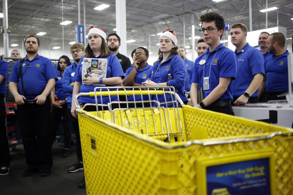 Employees gather for a meeting before opening the doors at a Best Buy store in Louisville, Ky., U.S., on Nov. 23, 2017. MUST CREDIT: Bloomberg photo by Luke Sharrett