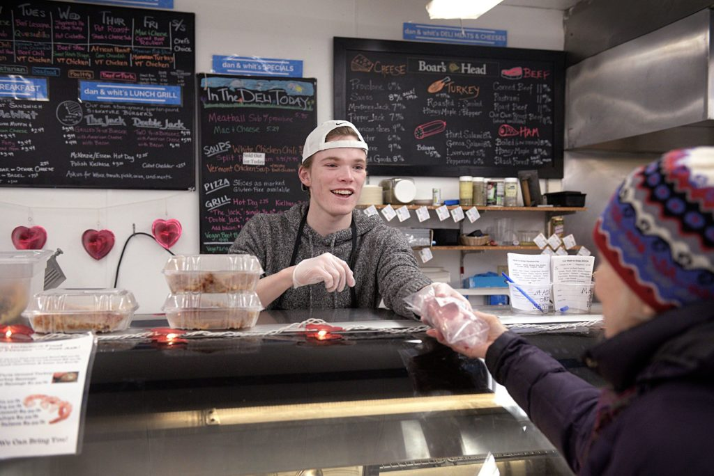 David Seigne, of Norwich, Vt., works behind the deli counter at Dan & Whit's General Store in Norwich, Vt., on Jan. 7, 2019. Seigne has worked at the store on and off for five years while studying at Boston University. (Valley News - Joseph Ressler) Copyright Valley News. May not be reprinted or used online without permission. Send requests to permission@vnews.com.
