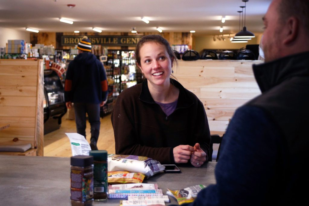 Co-owner Lauren Stevens talks with a distributor about new products for the store at the Brownsville Butcher & Pantry in Brownsville, Vt., on Jan. 17, 2019. (Valley News - Joseph Ressler) Copyright Valley News. May not be reprinted or used online without permission. Send requests to permission@vnews.com.