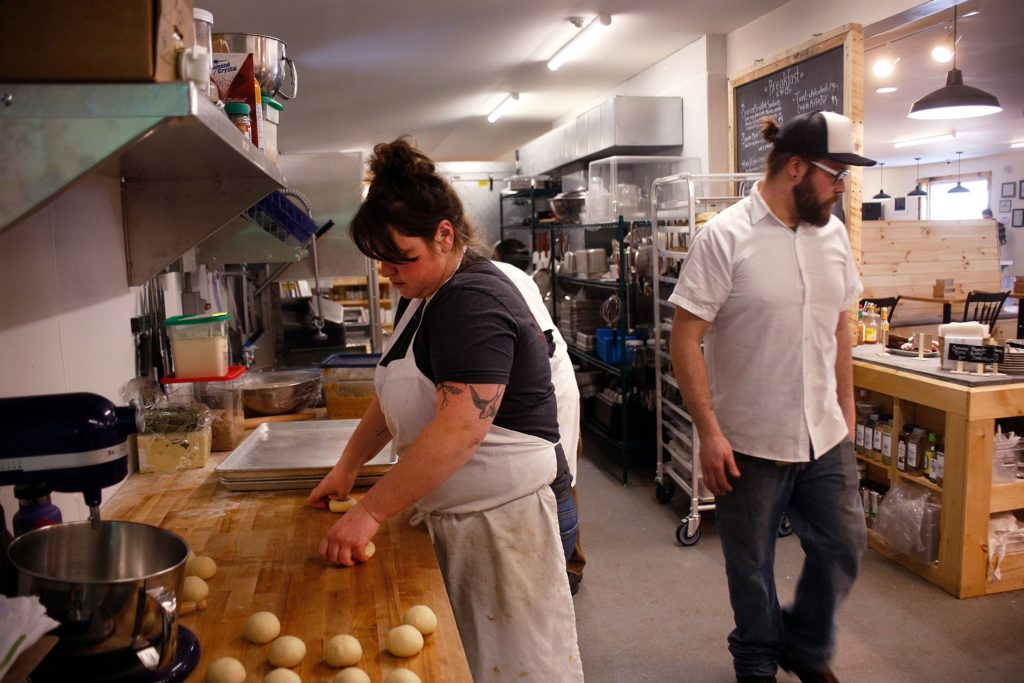 Head baker Laura Horner-Richardson, of Brownsville, makes the day's doughnuts as line cook Forrest Dubuc, of Woodstock, Vt., works at the Brownsville Butcher & Pantry in Brownsville, Vt., on Jan. 17, 2019. (Valley News - Joseph Ressler) Copyright Valley News. May not be reprinted or used online without permission. Send requests to permission@vnews.com.