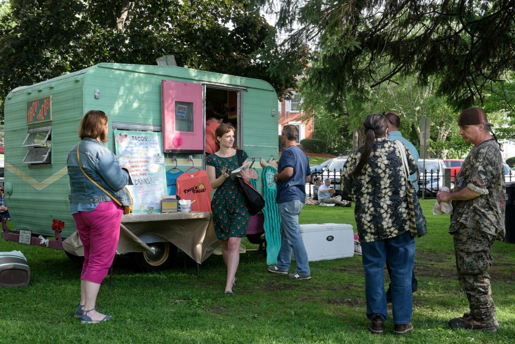 Kymberly Byerly, of Wilder, second from left, steps away from Taco's Tacos after placing her order during the Lebanon (N.H.) Food Truck Festival in Colburn Park, Friday, June 21, 2019. (Valley News - James M. Patterson) Copyright Valley News. May not be reprinted or used online without permission. Send requests to permission@vnews.com.