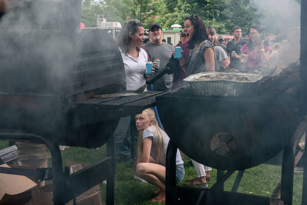 Customers wait in line at Boogalow's Island BBQ during the Lebanon (N.H.) Food Truck Festival in Colburn Park, Friday, June 21, 2019. (Valley News - James M. Patterson) Copyright Valley News. May not be reprinted or used online without permission. Send requests to permission@vnews.com.