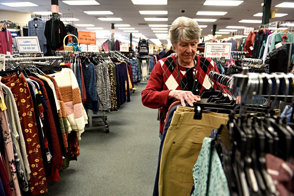 Pauline Robert organizes a clothing rack at Hubert's in Lebanon, N.H., on Saturday, Dec. 28, 2019. Robert has been working at the store for three years. (Valley News - Jennifer Hauck) Copyright Valley News. May not be reprinted or used online without permission. Send requests to permission@vnews.com.