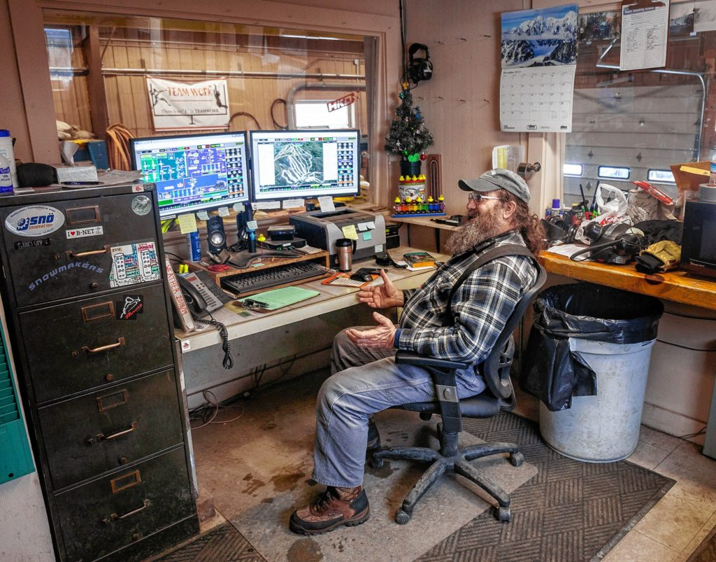 Night Operations Supervisor Fred Gallup in the snowmaking control room at Mount Sunapee resort in Newbury, NH on Sunday, January 5, 2020. Gallup has worked at the ski area for 41 years.