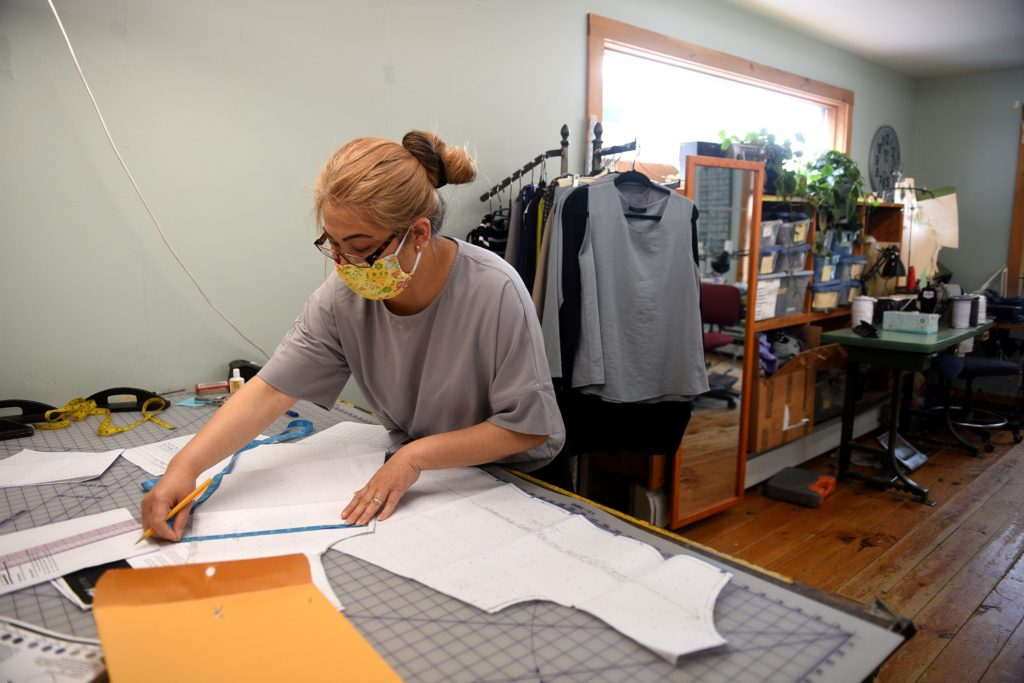 Along with her sister-inlaw, Lak Vorachak sewed 5,000 cloth masks for the Fat Hat Clothing Co. at her home during the pandemic. Vorachak was working at the store in Quechee, Vt., on Wednesday, July 1, 2020.  (Valley News - Jennifer Hauck) Copyright Valley News. May not be reprinted or used online without permission. Send requests to permission@vnews.com.