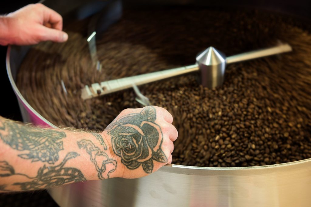 Clint Hunt, co-owner of Abracadabra Coffee Company, rests while a batch of freshly roasted beans cools in Woodstock, Vt., Tuesday, Oct. 6, 2020. (Valley News - James M. Patterson) Copyright Valley News. May not be reprinted or used online without permission. Send requests to permission@vnews.com.
