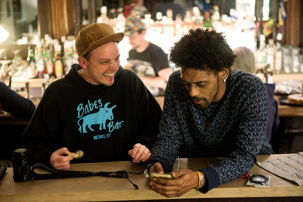 Owen Daniel-McCarter, co-owner of Babes Bar, left, talks with Tre Groves, of Braintree, right, in Bethel, Vt., Wednesday, Oct. 7, 2020. Daniel-McCarter and Jesse Plotsky, background, are working with Groves to develop a menu for a food trailer they plan to open outside the bar.  (Valley News - James M. Patterson) Copyright Valley News. May not be reprinted or used online without permission. Send requests to permission@vnews.com.