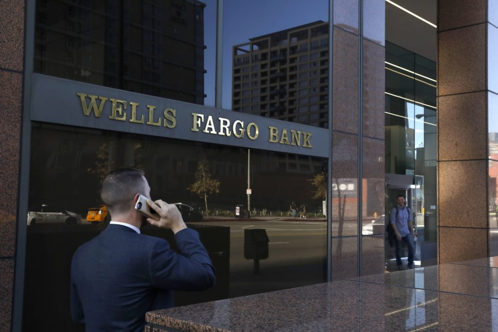 A pedestrian walks past a Wells Fargo bank in downtown Los Angeles on Feb. 5, 2018. (Mel Melcon/Los Angeles Times/TNS)