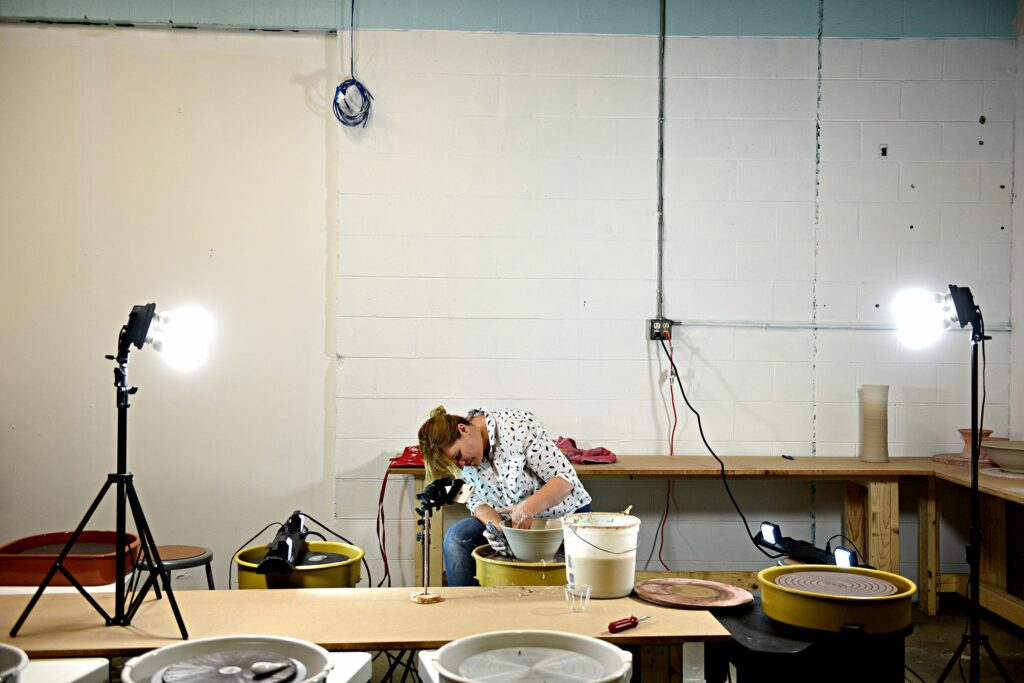 Georgia Donnelly records a time lapse video at the Big Ceramic Store in West Lebanon, N.H., on Wednesday, July 3, 2019. Donnelly makes  videos to talk about the products the store sells and techniques for potters. (Valley News - Jennifer Hauck) Copyright Valley News. May not be reprinted or used online without permission. Send requests to permission@vnews.com.