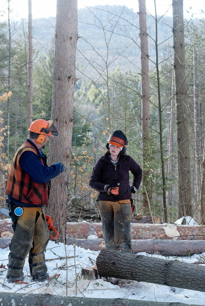Tuilelaith Nepveu-McCrory, right, listens to advice from her dad, Carl Russell while clearing pasture in Bethel Gilead, Vt., Thursday, Jan. 13, 2021. Nepveu-McCrory felled and limbed trees as Russell kept the area clear and logs organized with his oxen. (Valley News - James M. Patterson) Copyright Valley News. May not be reprinted or used online without permission. Send requests to permission@vnews.com.