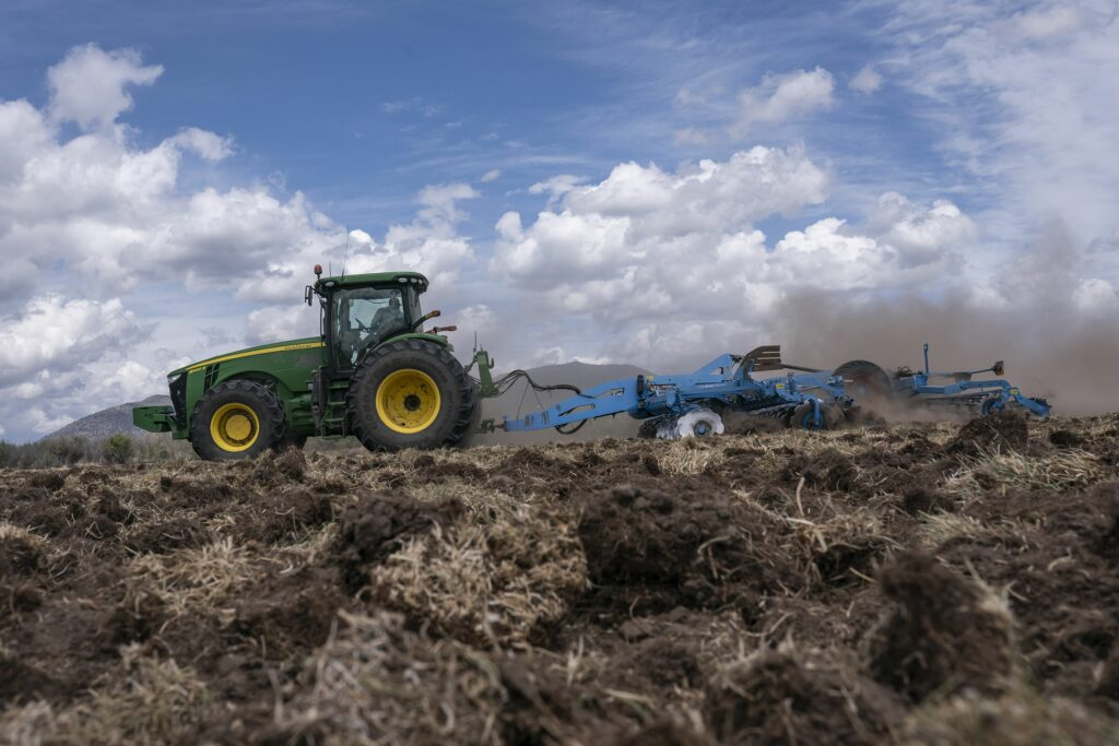 A tractor tears dried dirt on land that was unplanted this year due to the water shortage on Wednesday, June 9, 2021, in Tulelake, Calif. This summer for the first time ever, hundreds of farmers along the California-Oregon border who rely on irrigation from a depleted, federally managed lake aren't getting any water from it at all. Competition over the water in the Klamath Basin has always been intense, but this summer, because of a historic drought there is not enough water for the needs of farmers, Native American tribes and wildlife refuges. (AP Photo/Nathan Howard)